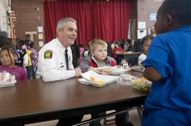 Jackson Police Chief Matt Heins talks with students