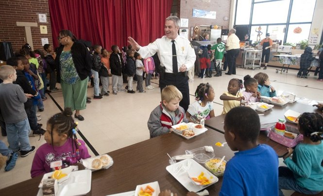Jackson Police Chief Matt Heins waves to students